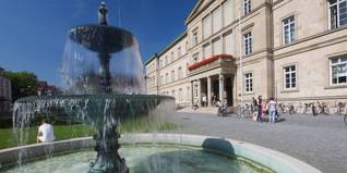 Fountain and Geschwister-Scholl-Platz in front of the Neue Aula in Tübingen